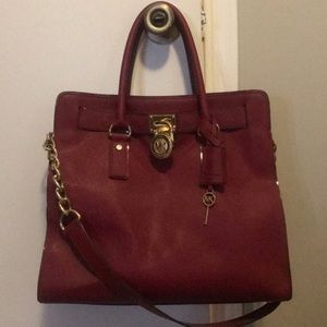 Authentic Michael Kors purse and matching wallet